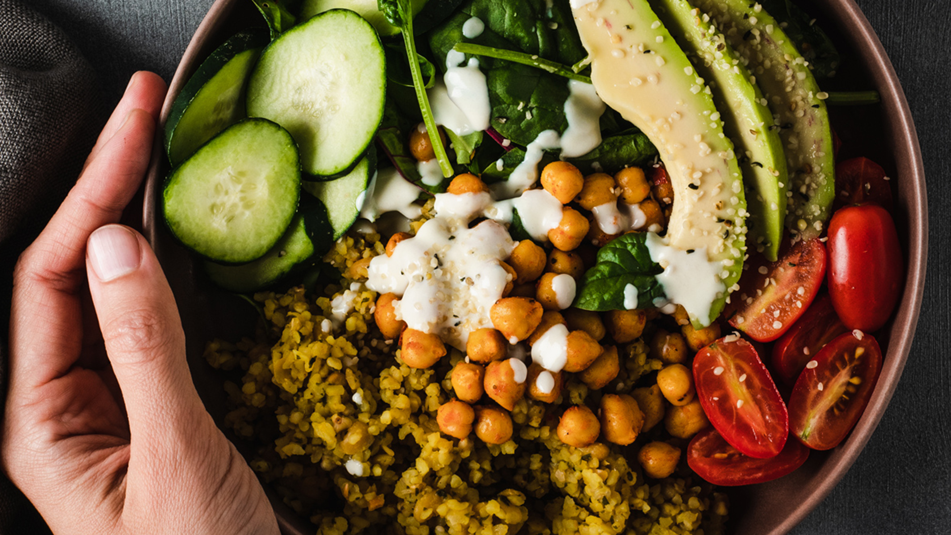 Organic Buddha Bowl with legumes and bulgur with artichokes